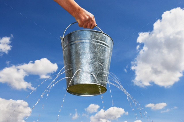 Man Holding Leaking Bucket